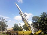 The S-75 Dvina (Russian: С-75; NATO reporting name SA-2 Guideline) is a Soviet-designed, high-altitude, command guided, surface-to-air missile (SAM) system. Since its first deployment in 1957, it has become the most widely-deployed and -used air defense missile in history, scoring the first successful engagement of an enemy aircraft by a SAM ever, shooting down a Taiwanese RB-57D over China, on October 7, 1959 by hitting it with three V-750 (1D) missiles at an altitude of 20 km (65,600 ft).<br/><br/>  This system first gained international fame when an S-75 battery, using the newer, longer range and higher altitude V-750VN (13D) missile shot down the U-2 of Francis Gary Powers overflying the Soviet Union on May 1, 1960. The system was also deployed in Cuba during the Cuban Missile Crisis, where on October 27, 1962, it shot down the U-2 flown by Rudolf Anderson, almost precipitating a nuclear war.<br/><br/>  Later, North Vietnamese forces used the S-75 extensively during the Vietnam War to defend Hanoi and Haiphong with some considerable success, especially during Operations Linebacker 1 and 2 in 1972. During these operations the PAVN claim 755 USAF aircraft destroyed including 34  B52 bombers, while the US admits to 159 aircraft lost including 16 B 52 bombers.