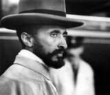 Haile Selassie I (Ge'ez: 'Power of the Trinity', 23 July 1892 – 27 August 1975), born Tafari Makonnen, was Ethiopia's regent from 1916 to 1930 and Emperor of Ethiopia from 1930 to 1974.<br/><br/>  The heir to a dynasty that traced its origins to the 13th century, and from there by tradition back to King Solomon and the Queen of Sheba, Haile Selassie is a defining figure in both Ethiopian and African history. At the League of Nations in 1936, the Emperor condemned the use of chemical weapons by Italy against his people. His internationalist views led to Ethiopia becoming a charter member of the United Nations, and his political thought and experience in promoting multilateralism and collective security have proved seminal and enduring.<br/><br/>  His suppression of rebellions among the nobles, as well as what some perceived to be Ethiopia's failure to modernize adequately, earned him criticism among some contemporaries and historians. Haile Selassie is revered as the returned Messiah of the Bible, God incarnate, among the Rastafari movement, the number of followers of which is estimated between 200,000 and 800,000. Begun in Jamaica in the 1930s, the Rastafari movement perceives Haile Selassie as a messianic figure who will lead a future golden age of eternal peace, righteousness, and prosperity. He himself remained an Ethiopian Orthodox Christian throughout his life.